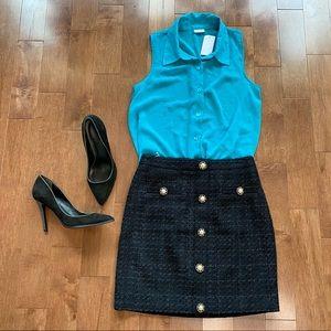 Blue high-low button down sleeveless shirt